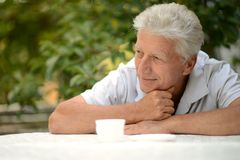 Elderly man with cup of coffee Royalty Free Stock Photos