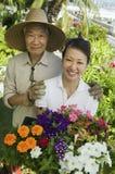 Elderly Man With Daughter In Garden. Portrait of a happy elderly men with daughter in garden Stock Photos