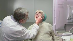 Elderly man at the dentist. stock video footage
