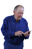 Elderly man dialing cell phone Royalty Free Stock Photo