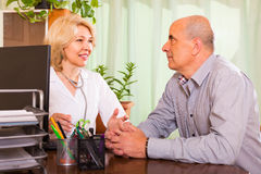 Elderly man with doctor in clinic Royalty Free Stock Photo