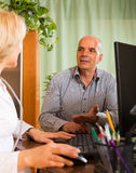 Elderly man with doctor in clinic Royalty Free Stock Photos