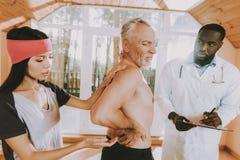 Elderly Man. Doctors Examine Body. Sport Uniform. stock image
