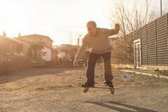 Elderly man does stunts on skateboards regardless of age. Concept of elderly man with youthful attitude