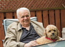 Elderly Man and Dog Stock Images