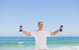 Elderly man doing his exercises Stock Photo