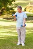 Elderly man doing his exercises in the park Royalty Free Stock Photography