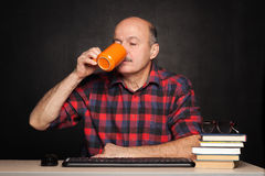 Elderly man drinking coffee during the break. Rest of the study, Royalty Free Stock Images