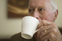Elderly Man Drinking Coffee Stock Photos