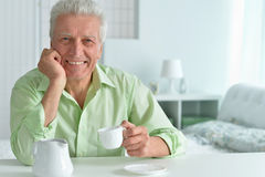 Elderly man drinking cup of coffee Royalty Free Stock Photo