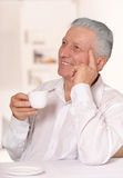 Elderly Man Drinking Cup Of Coffee Royalty Free Stock Photography