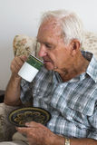 Elderly Man Drinking a Cup of Tea. Stock Photos