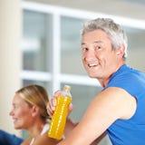 Elderly man drinking sports drink Stock Photo