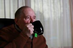 Elderly man drinking tea Stock Image