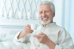 Elderly man drinking tea Royalty Free Stock Images