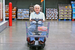 Elderly man drives motorized wheelchair royalty free stock image