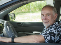 Elderly man driving car Royalty Free Stock Photo
