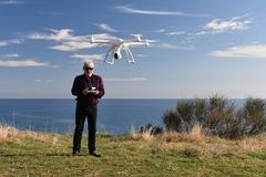 Elderly man with drone stock image