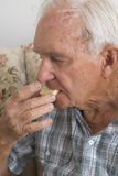 Elderly Man Eating Shortbread. Royalty Free Stock Image