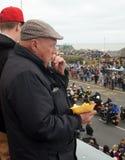 Elderly man eats chips Royalty Free Stock Photography