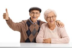 Elderly man and an elderly woman with the elderly man holding hi Stock Photos