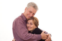 Elderly man embraces a woman on a white background Royalty Free Stock Photo