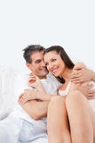 Elderly man embracing happy woman Stock Images