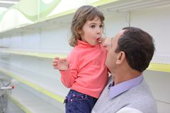 Elderly man at empty shelves in shop with child Stock Photography