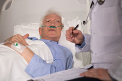 Elderly man examined by doctor royalty free stock image