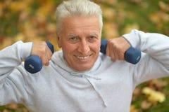Elderly man exercising Stock Photography
