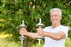 Elderly man exercising with dumbbells Royalty Free Stock Image