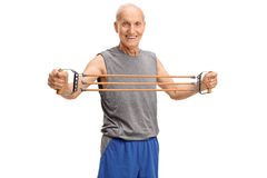 Elderly man exercising with a resistance band Stock Images