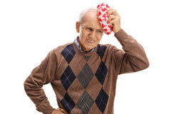 Elderly man experiencing a headache. Isolated on white background Stock Images