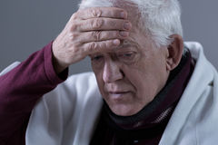 Elderly man with fever Stock Images