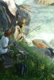 Elderly man fishing in the sea Stock Photo