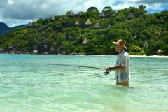 Elderly man fishing in the sea Royalty Free Stock Photography