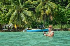 Elderly man fishing in the sea Royalty Free Stock Photos