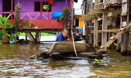 Elderly Man Fixing a Canoe. IQUITOS, PERU - MARCH 17: Elderly man fixes a canoe in Iquitos, Peru on March 17, 2015 royalty free stock images