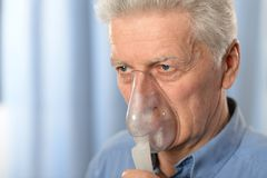 Elderly man with flu Stock Images
