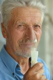 Elderly man with flu inhalation Royalty Free Stock Photo