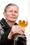 Elderly man with glass of wine. Isolated Stock Photos