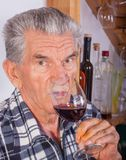Elderly man with a glass of wine stock images