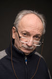 An elderly man with glasses Royalty Free Stock Image
