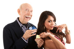 Elderly man with gold-digger companion or wife stock photos