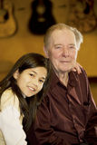 Elderly man with granddaughter Royalty Free Stock Image