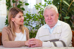 Elderly man with granddaughter Royalty Free Stock Photo
