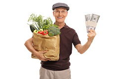Elderly man groceries and money Royalty Free Stock Photography