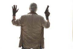 Elderly man with a gun surrenders Royalty Free Stock Photography