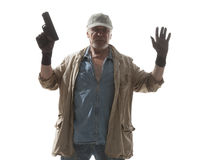 Elderly man with a gun surrenders Stock Photography
