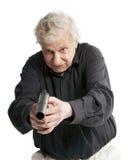 Elderly man with gun Royalty Free Stock Photo